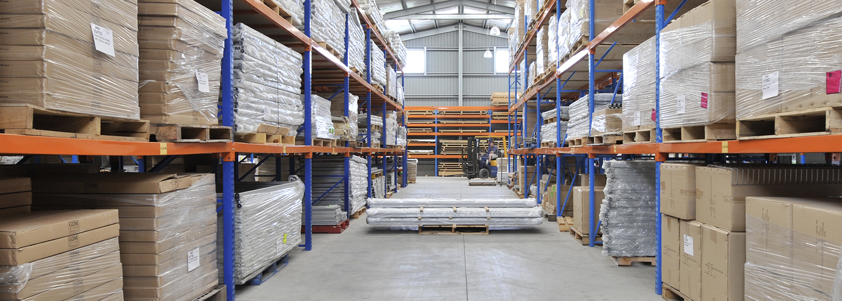 Heavy duty racking for storing loaded pallets.